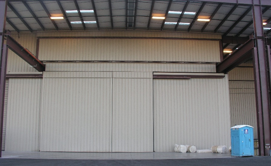 The two photos above show the larger 61-foot 6-inch door in the open and closed positions. The hydraulic door has a clear opening height ... & Hydraulic Crane Doors Help CAID Industries Save Money Time   2016 ...