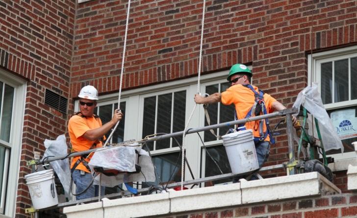 western workers repairing masonry 728