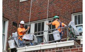 Western Workers repairing masonry